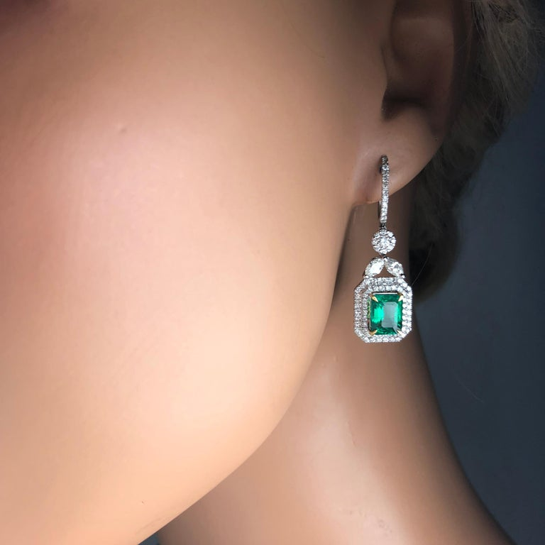 Contemporary 3.10 Carat Emerald Halo Lever-Back Dangle Earrings in 18k White and Yellow Gold For Sale