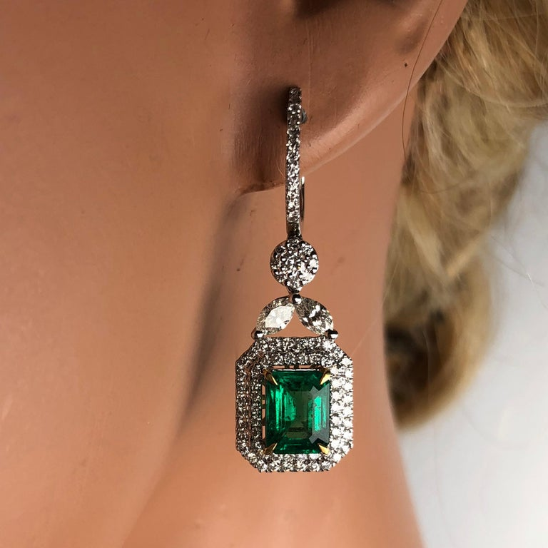 3.10 Carat Emerald Halo Lever-Back Dangle Earrings in 18k White and Yellow Gold In New Condition For Sale In New York, NY