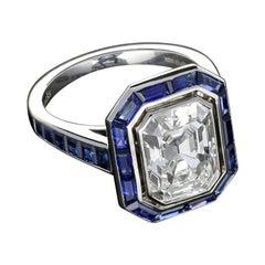 Hancocks 3.10 Carat G SI1 Emerald Cut Diamond & Calibre-Cut Sapphire Ring
