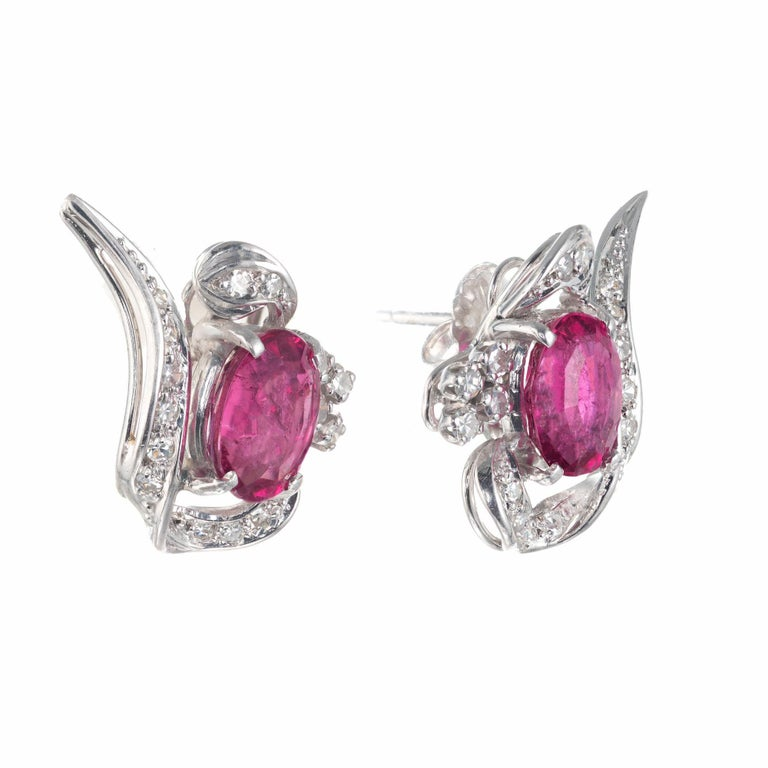 1960's tourmaline diamond swirl earrings. 2 oval pink tourmaline's in 18k white gold swirl design settings with 32 single cut accent diamonds.   2 oval pink tourmaline, SI2-I approx. 3.10cts 32 single cut diamonds, H-I VS-SI approx. .24cts 18k white