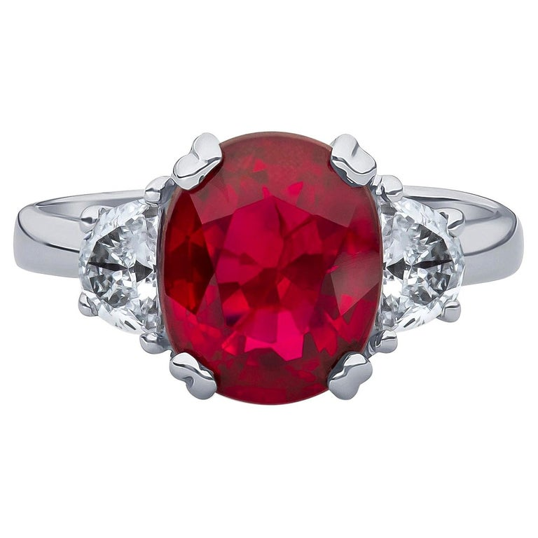 3.11 Carat Oval Cut Natural Thai Ruby Ring with 0.50 Carat Total of Diamonds For Sale