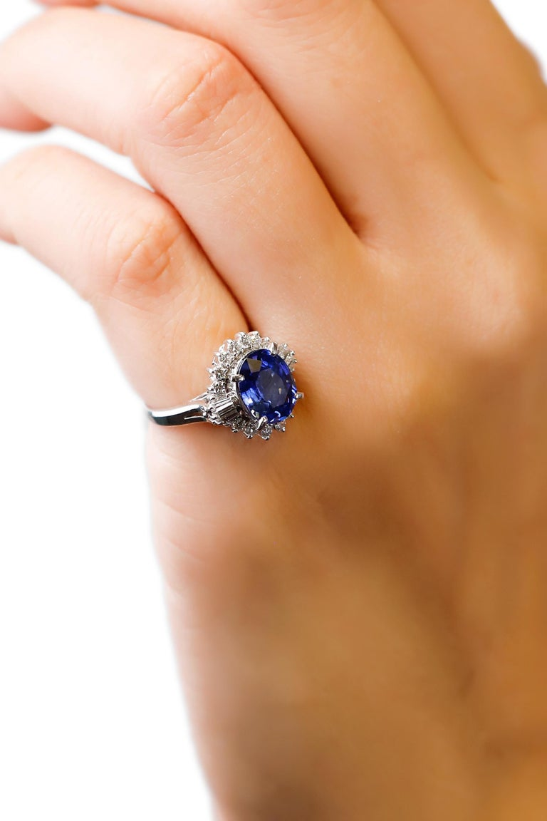 3.11Ct Oval Sapphire 0.61Ct Diamond Platinum Halo Engagement Ring Sz 4.5  Oval sapphire diamond halo cluster engagement ring, handmade Platinum prong setting. The Sapphire changes color from Purple blue in daylight to purple in incandescent