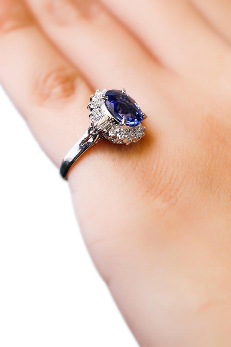 Oval Cut 3.11 Carat Oval Blue Sapphire 0.61 Carat Diamond Platinum Halo Ring Engagement For Sale