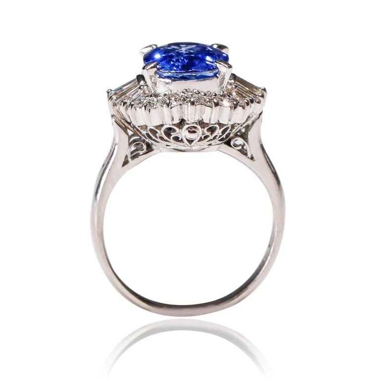 3.11 Carat Oval Blue Sapphire 0.61 Carat Diamond Platinum Halo Ring Engagement In New Condition For Sale In New York, NY