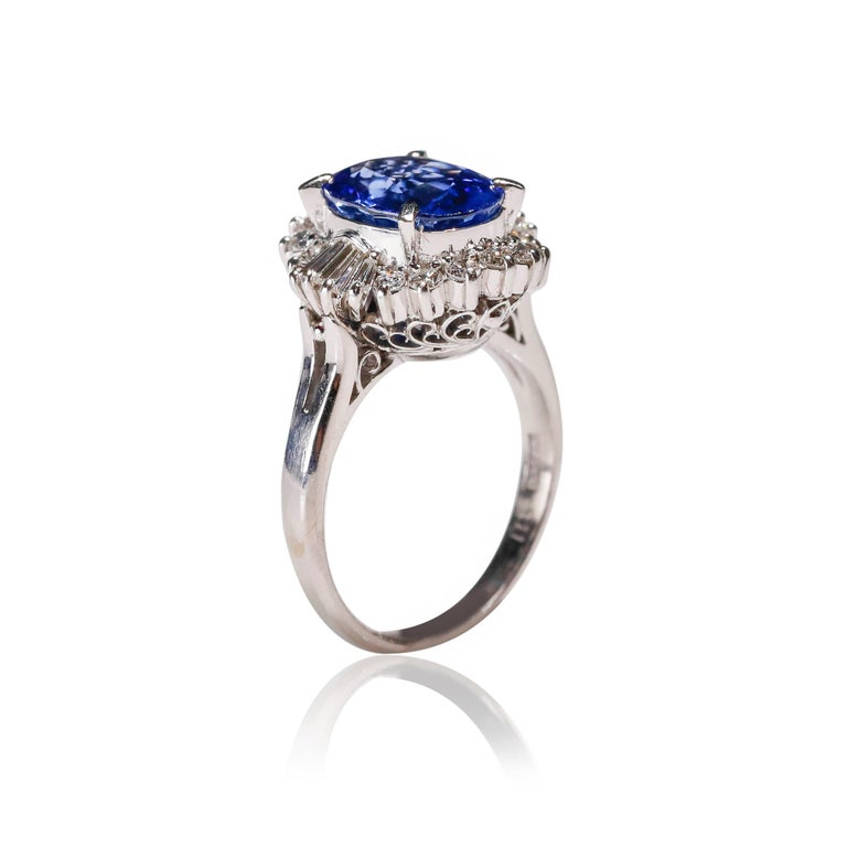 Women's 3.11 Carat Oval Blue Sapphire 0.61 Carat Diamond Platinum Halo Ring Engagement For Sale
