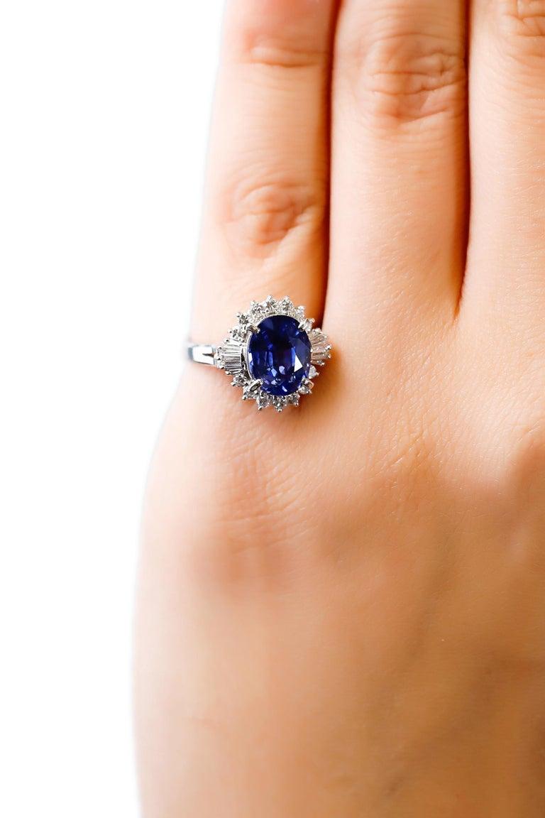 3.11 Carat Oval Blue Sapphire 0.61 Carat Diamond Platinum Halo Ring Engagement For Sale 1