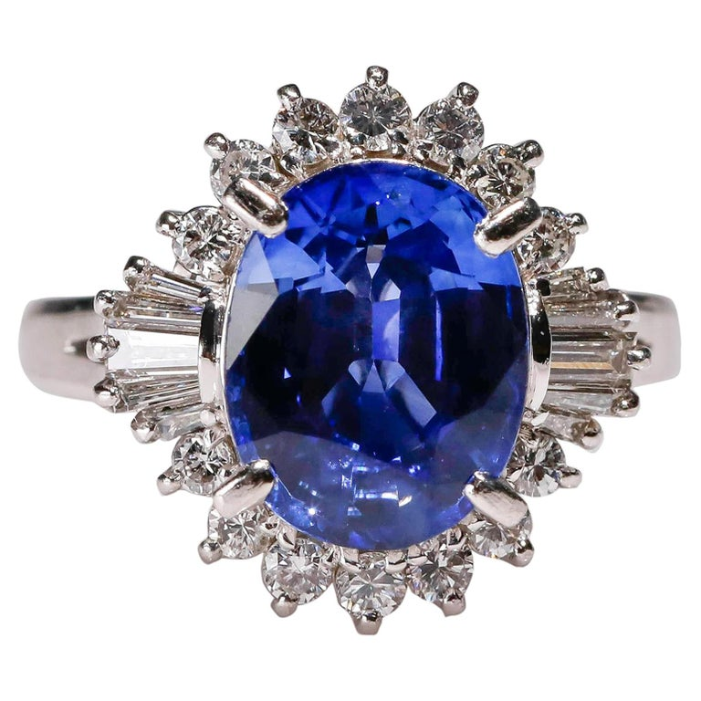 3.11 Carat Oval Blue Sapphire 0.61 Carat Diamond Platinum Halo Ring Engagement For Sale