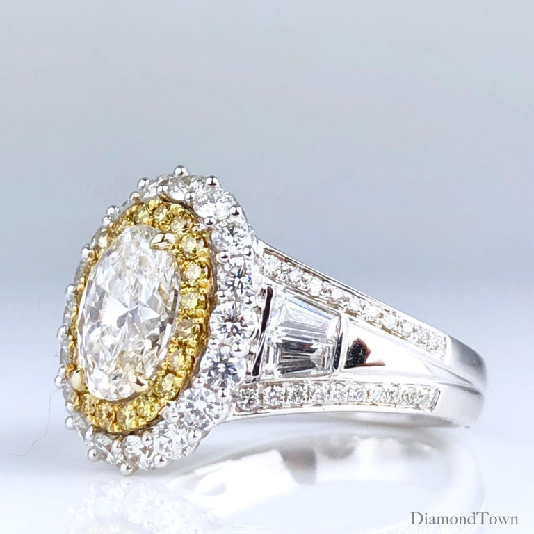Contemporary 3.12 Carat Oval Cut Diamond Ring with Double Halo of White and Yellow Diamonds For Sale