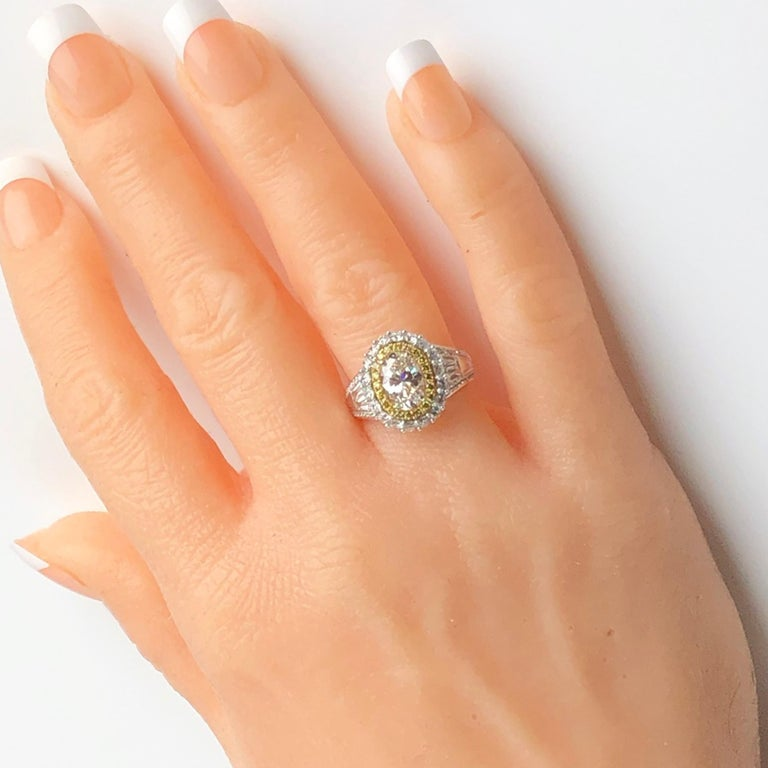 3.12 Carat Oval Cut Diamond Ring with Double Halo of White and Yellow Diamonds In New Condition For Sale In New York, NY