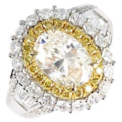 3.12 Carat Oval Cut Diamond Ring with Double Halo of White and Yellow Diamonds