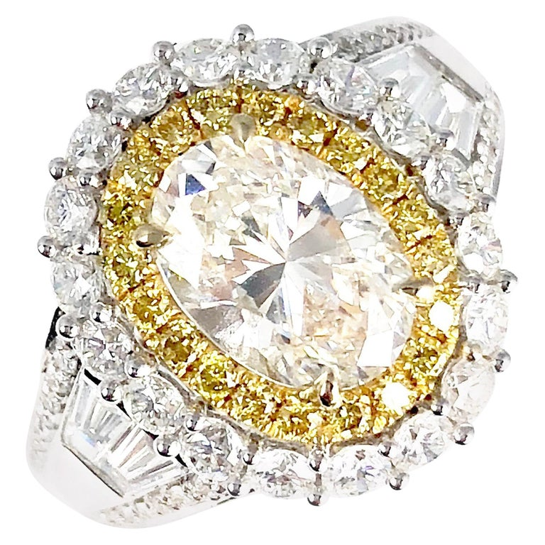 3.12 Carat Oval Cut Diamond Ring with Double Halo of White and Yellow Diamonds For Sale