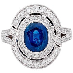 3.13 Carat Blue Sapphire 18 Carat White Gold Diamond Halo Ring