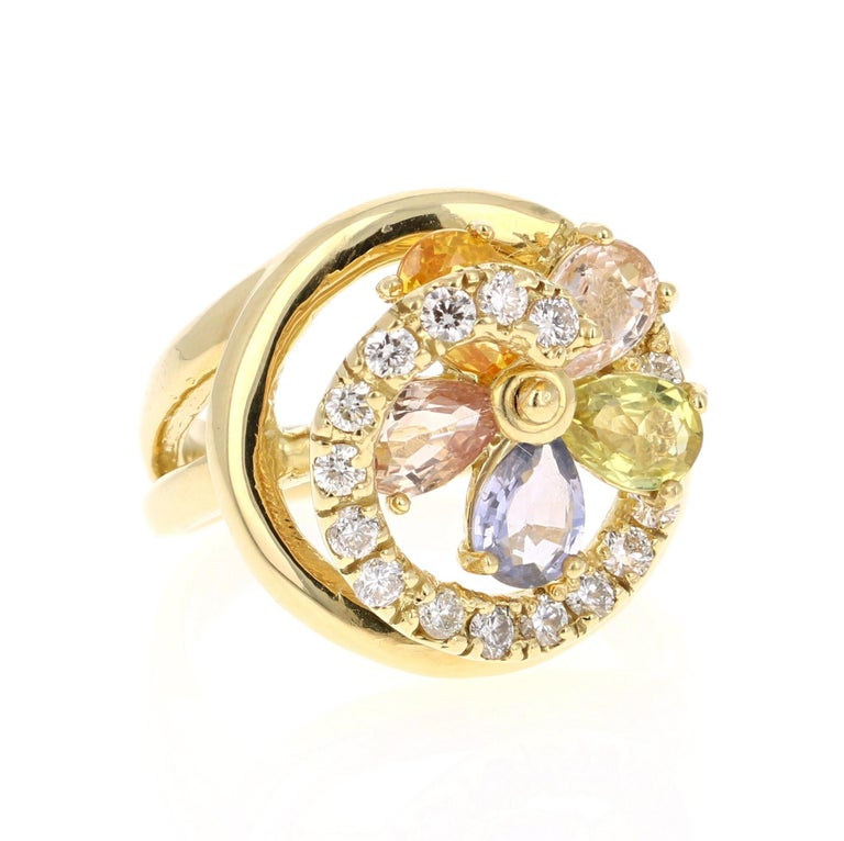 Beautiful and Unique Multi Sapphire & Diamond Movable Ring!  This ring has 5 Pear Cut Multi-Colored Sapphires that weigh 2.60 Carats. It also has 18 Round Cut Diamonds that weigh 0.53 Carats. Clarity: VS and Color: H. The total carat weight of the