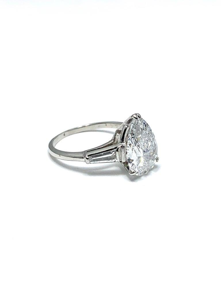 Modern 3.14 Carat D SI1 Pear Shape Diamond and Baguette Diamond Platinum Ring For Sale