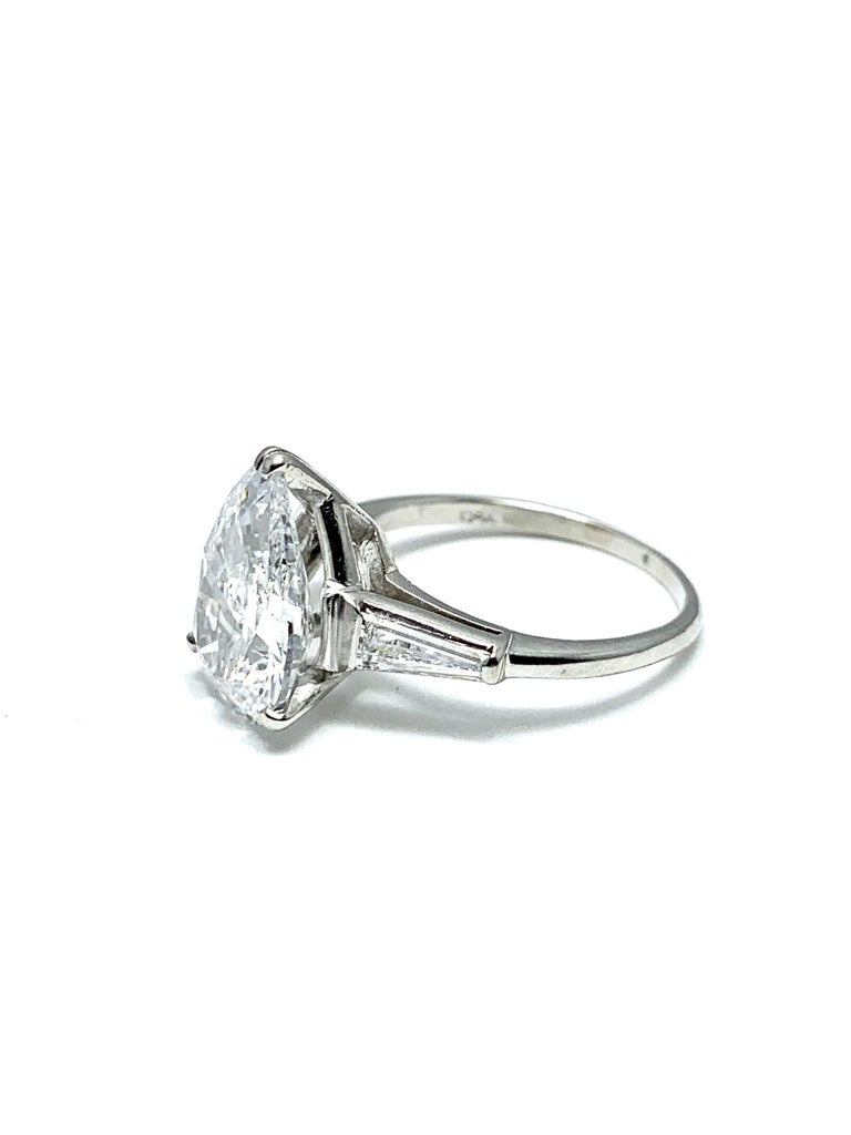 Pear Cut 3.14 Carat D SI1 Pear Shape Diamond and Baguette Diamond Platinum Ring For Sale