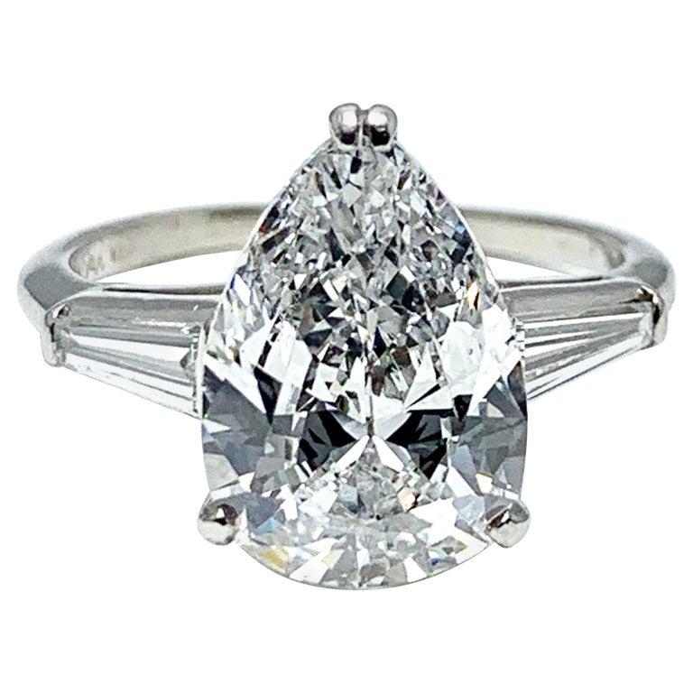 3.14 Carat D SI1 Pear Shape Diamond and Baguette Diamond Platinum Ring For Sale