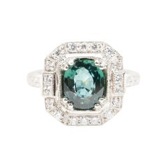 3.14 Carat Oval No Heat Colour Shifting Sapphire and Diamond Platinum Ring