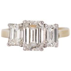 3.14 Carat Total Diamond, Platinum, 18 Karat Gold Three-Stone Emerald Cut Ring