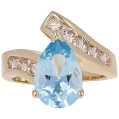 3.15 Carat Pear Cut Aquamarine and Diamond Ring, 14 Karat Yellow Gold Bypass