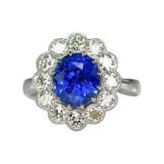 3.16 Carat Blue Sapphire and Diamond Cluster Engagement Ring