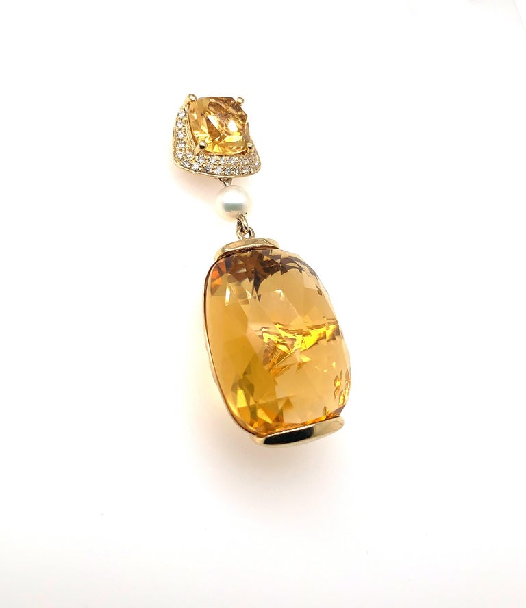 Glamorous Gemstones - Sunita Nahata started off her career as a gemstone trader, and this particular collection reflects her love for multi-coloured semi-precious gemstones. This earring presents vibrant honey quartz that are cut by expert artisans