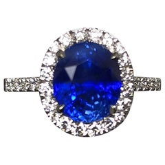 3.17 carat Blue Sapphire and  Halo Cluster Diamond ring in Platinum