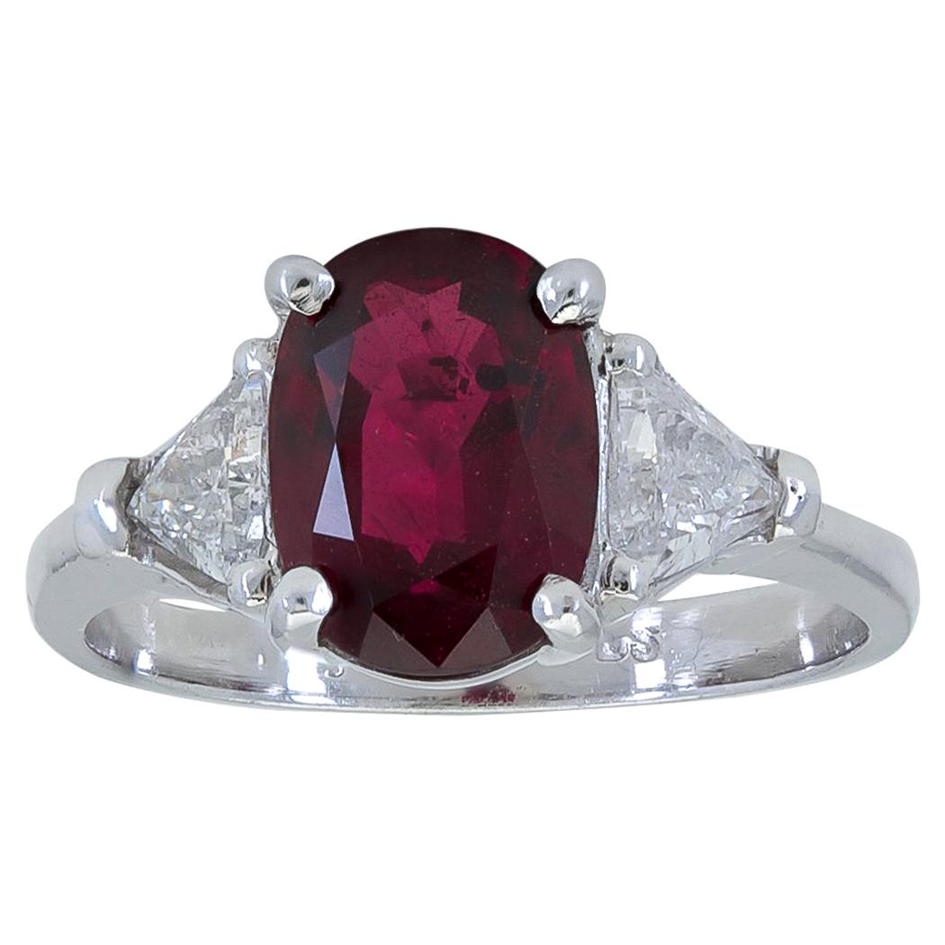 3.17 Carat Oval Cut Ruby and Diamond Three-Stone Engagement Ring