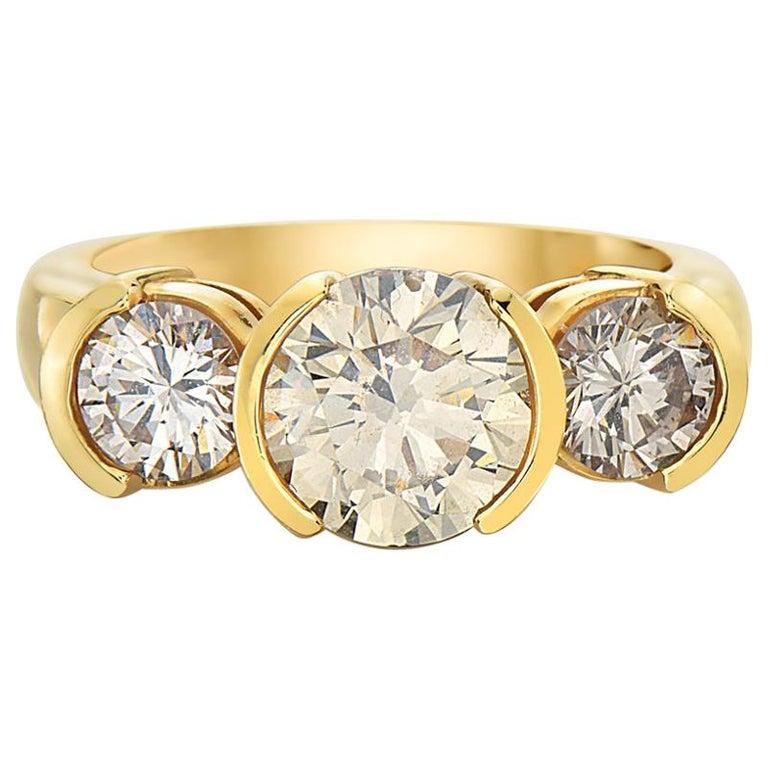 3.18 Carat 14 Karat Yellow Gold Round Brilliant Trinity Engagement Ring For Sale