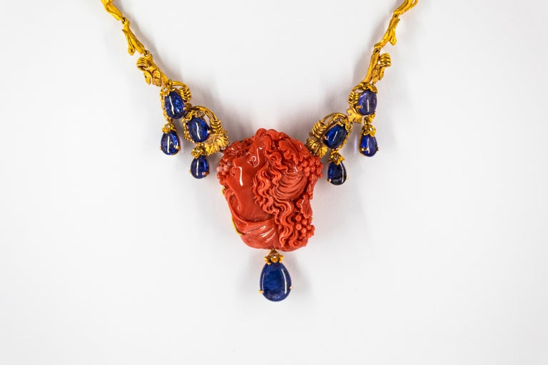 31.93 Carat Tanzanite White Diamond Pink Carved Coral Yellow Gold Greek Necklace For Sale 9