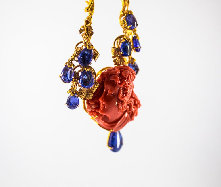 31.93 Carat Tanzanite White Diamond Pink Carved Coral Yellow Gold Greek Necklace For Sale 11