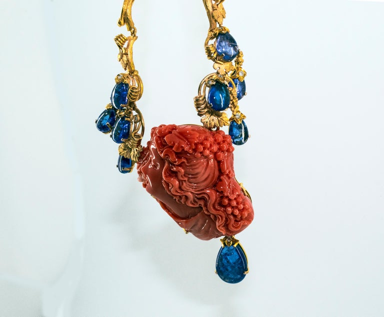 31.93 Carat Tanzanite White Diamond Pink Carved Coral Yellow Gold Greek Necklace For Sale 12