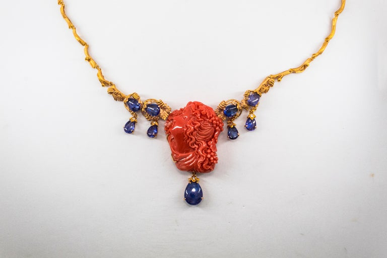 31.93 Carat Tanzanite White Diamond Pink Carved Coral Yellow Gold Greek Necklace For Sale 1