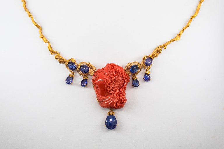 31.93 Carat Tanzanite White Diamond Pink Carved Coral Yellow Gold Greek Necklace For Sale 2