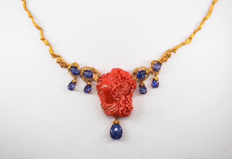 31.93 Carat Tanzanite White Diamond Pink Carved Coral Yellow Gold Greek Necklace For Sale 3
