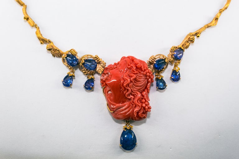 31.93 Carat Tanzanite White Diamond Pink Carved Coral Yellow Gold Greek Necklace For Sale 4