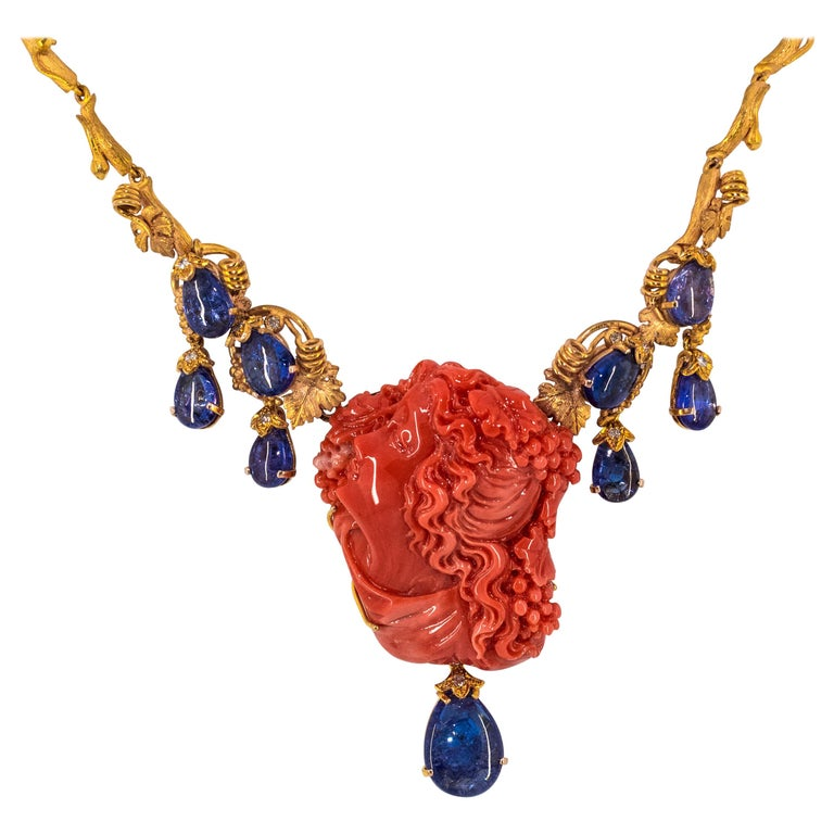 31.93 Carat Tanzanite White Diamond Pink Carved Coral Yellow Gold Greek Necklace For Sale