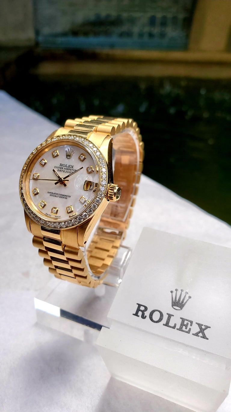 Rolex Midsize Presidential 18 Karat Yellow, Mother of Pearl Diamond Dial, Bezel In Excellent Condition For Sale In New Orleans, LA