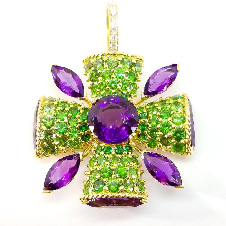 This Custom Designed and Crafted, One of a Kind Statement Enhancer Pendant by Artisan Tom Castor features Brilliant Contrasting Color and a Large Presence in the Classic Maltese Cross Style. Set in the center of the Cross is a large, Round Amethyst