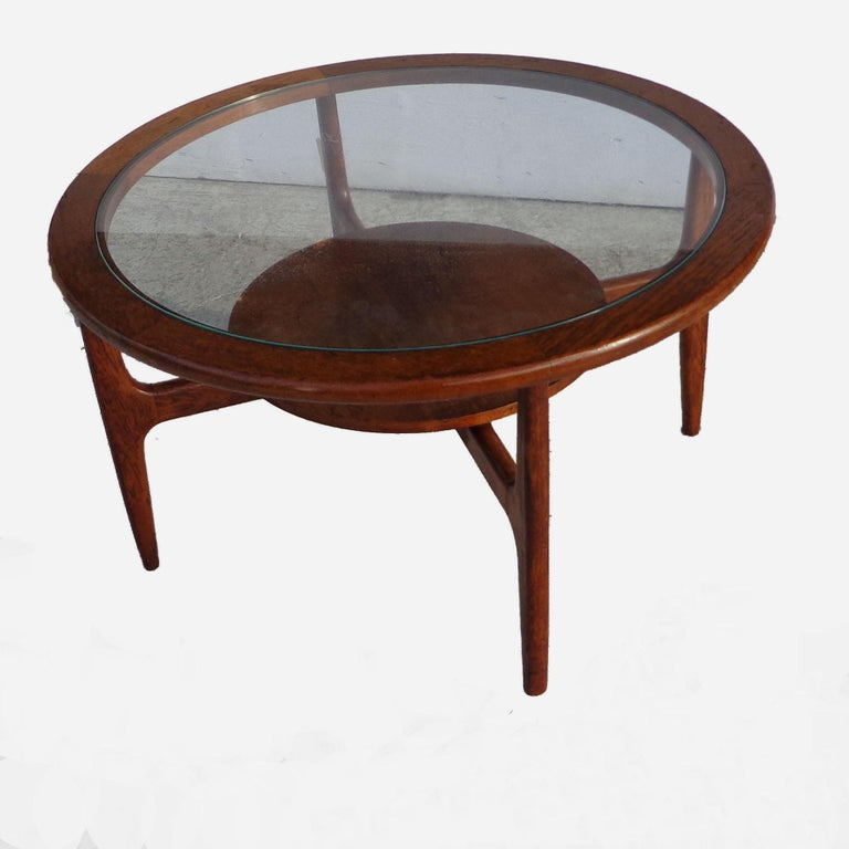Mid century 2-tier coffee table  Walnut with 2 levels for storage. Tapered legs. 32