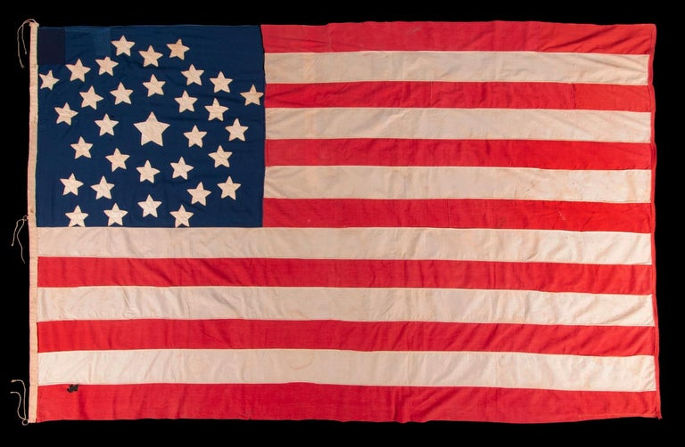 """32 STARS IN A VERY UNUSUAL NOTCHED VERSION OF THE """"GREAT STAR"""" PATTERN, WITH TWO STARS ABSENT AT THE EXTREME POINTS OF EACH ARM, MADE IN THE PERIOD WHEN MINNESOTA JOINED THE UNION AS THE 32ND STATE; A VERY RARE STAR COUNT, OFFICIAL FOR JUST ONE"""