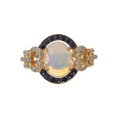 3.20 Carat Ethiopian Opal Cabochon Blue Sapphire Diamond Ring