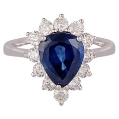 3.20 Carat Pear Shaped Blue Sapphire and Diamond Ring Studded In 18 Karat Gold