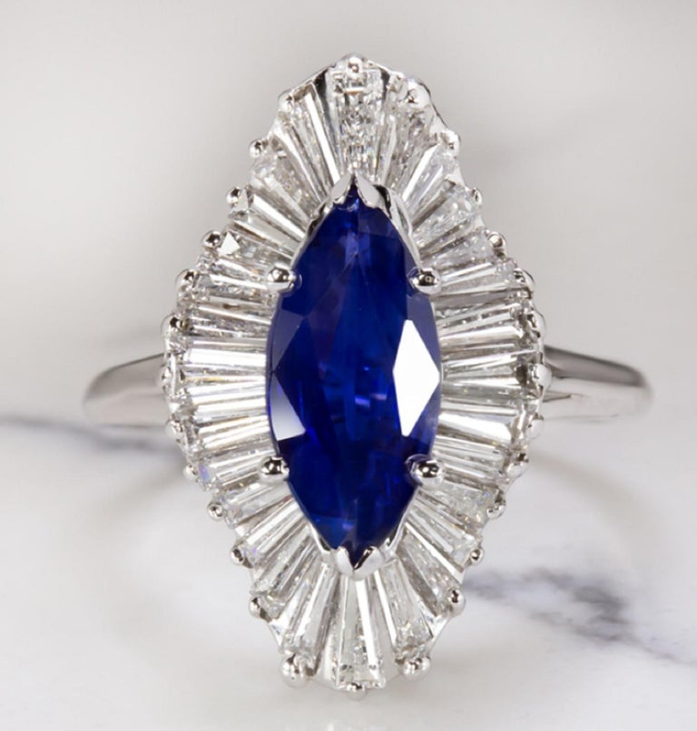 Very beautiful solitaire ring with a main marquise sapphire and a halo of very pure diamonds being E/G color and exceptional VVS clarity