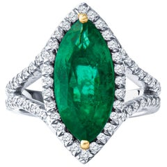 3.21ct Marquise Emerald and 1.07ct Round Diamond Halo Split Shank Platinum Ring
