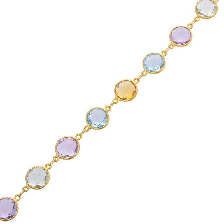Simple 32.23 carats round briolette in various gems are perfect for your summer and spring wardrobe. Mounted in 18 karats yellow gold. The total length of bracelet - 8 inches size of gemstones- 10x10 mm