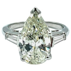 3.24 Carat Pear Shape Diamond and Tapered Baguette Diamond Platinum Ring