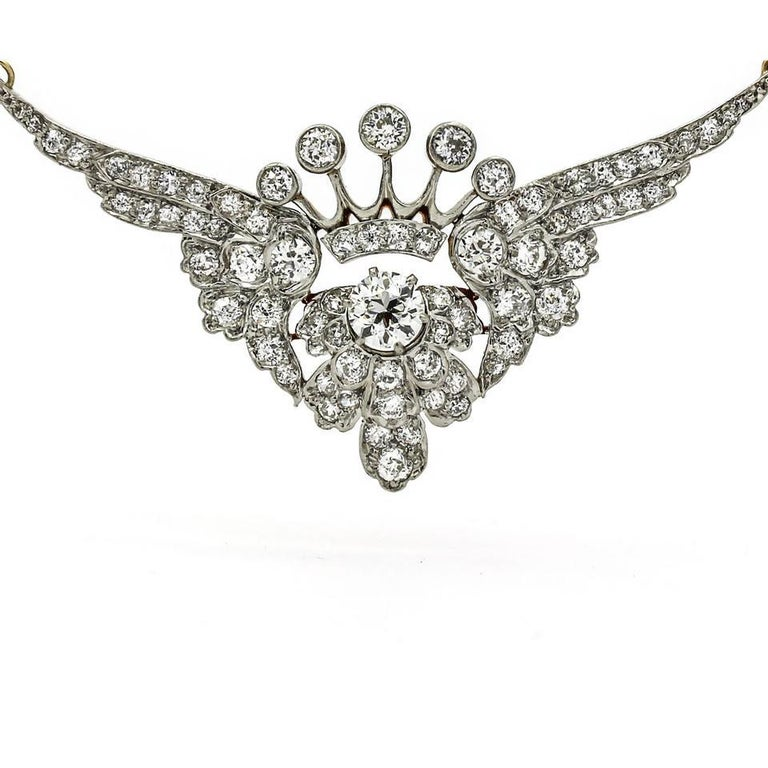 Old Mine Cut 3.25 Carat Platinum 18k Gold Diamond Art Deco Crown with Wings Pendant Necklace For Sale