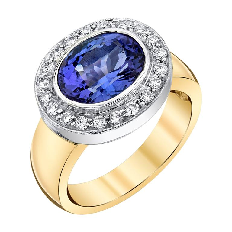 3.26 ct.Tanzanite, Diamond Halo, 18k White Gold Bezel and Yellow Gold Band Ring For Sale