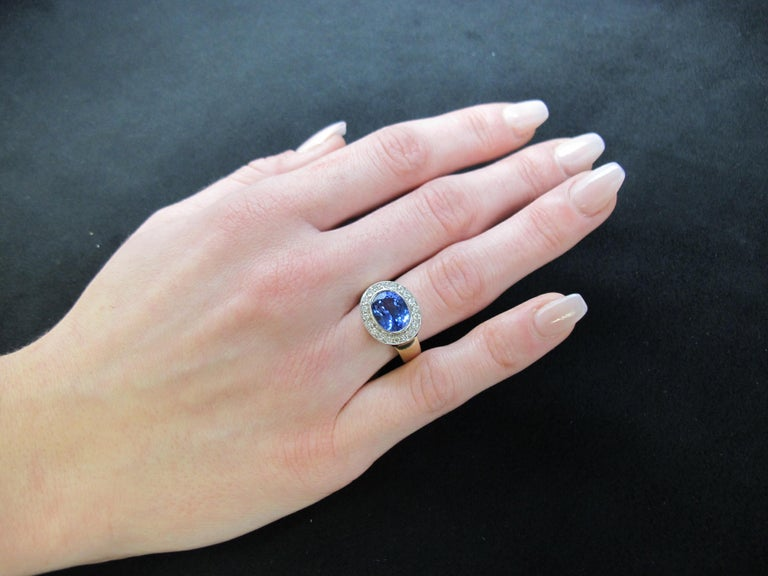 This vivid periwinkle blue tanzanite ring is a dazzling treat for the eyes! The tanzanite is a rich violetish-blue color and is encircled by a halo of pave set brilliant cut diamonds. This ring is modern, yet classic; truly timeless! It can be worn