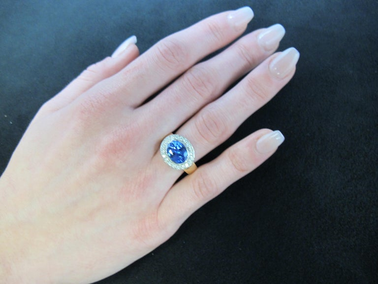 Oval Cut 3.26 ct.Tanzanite, Diamond Halo, 18k White Gold Bezel and Yellow Gold Band Ring For Sale